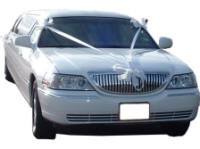 Cars for Stars (Sheffield) - Wedding Limo. White Lincoln stretched wedding limousine with white ribbons